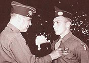 Pvt Milo Huempfner receives the DSC - (Courtesy: Gordon Stewart: WW II Airborne Demonstration Team)